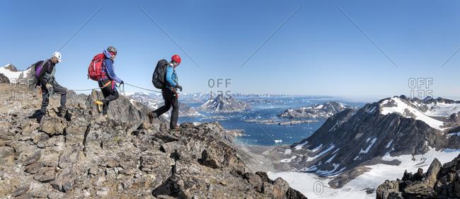 Greenland- Sermersooq- Kulusuk- Schweizerland Alps- mountaineers walking in rocky mountainscape