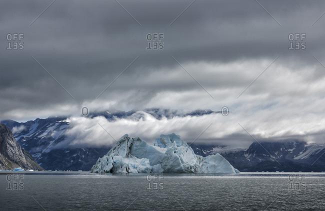 Greenland- Sermersooq- Kulusuk- Schweizerland Alps- iceberg in water