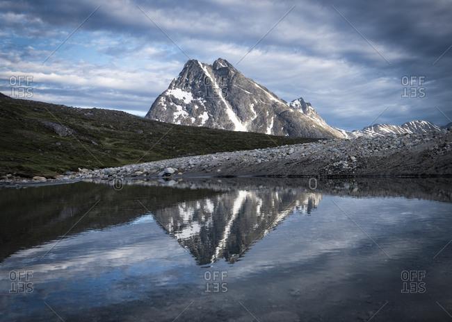 Greenland- Sermersooq- Kulusuk- Schweizerland Alps- mountain reflecting in water