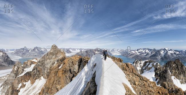 Greenland- Sermersooq- Kulusuk- Schweizerland Alps- mountaineers walking in snowy mountainscape