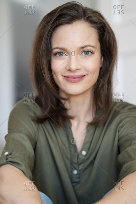 Portrait of smiling woman with brown hair