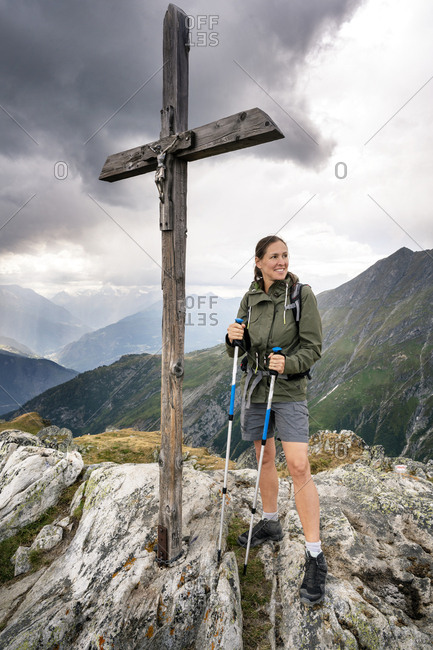 Switzerland- Valais- woman on a hiking trip in the mountains at Foggenhorn summit