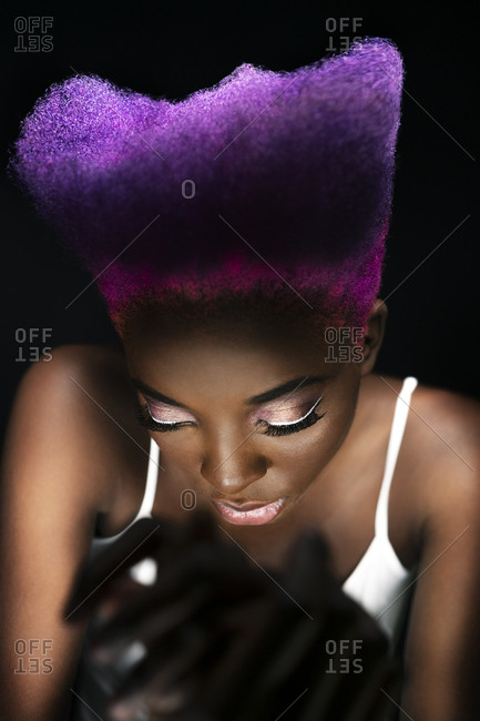 Portrait of eccentric young woman with pink and purple dyed hair