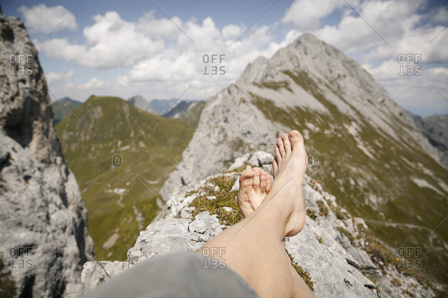 Austria- Tyrol- point of view shot of man's legs in mountainscape