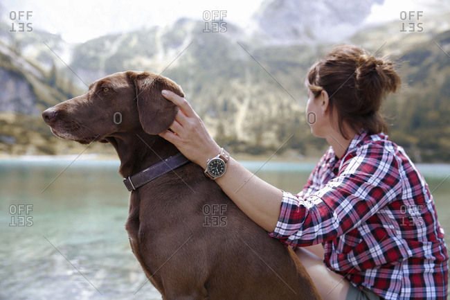 Austria- Tyrol- woman with dog at lake Seebensee