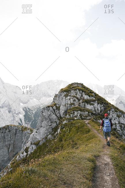 Austria- Tyrol- man hiking on mountain trail