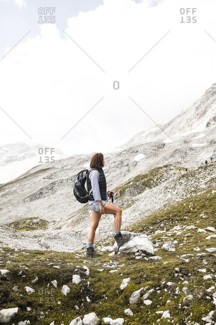 Austria- Tyrol- woman on a hiking trip in the mountains