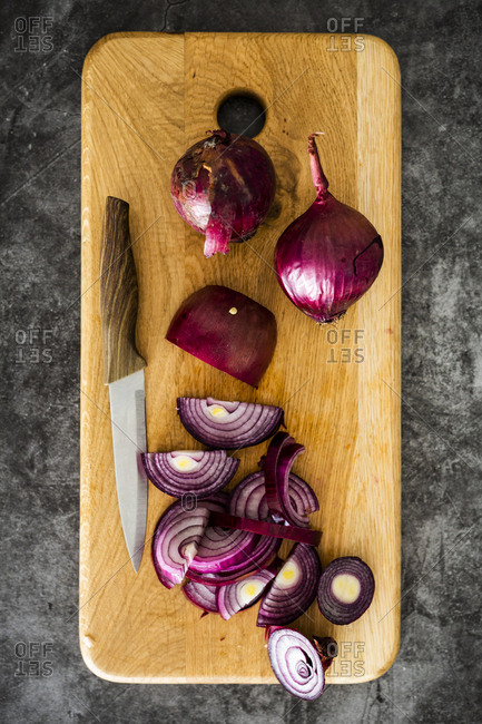 Red onion on chopping board- chopping