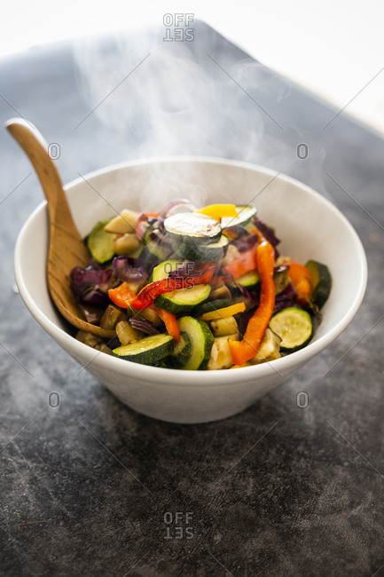 Mix of cooked vegetables in bowl- steaming
