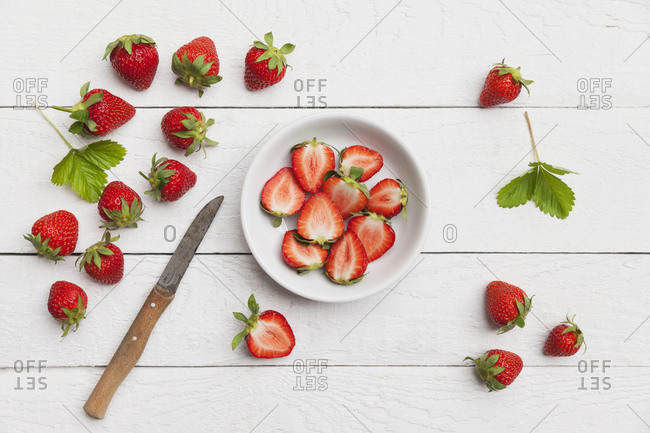 Strawberries- chopped in white bowl