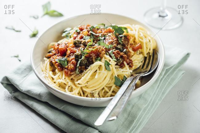 Spaghetti with tomato caper sauce- basil and parmesan