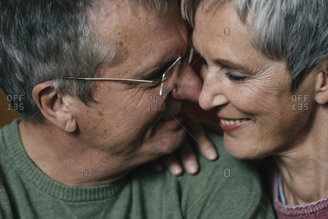 Close-up of happy affectionate senior couple