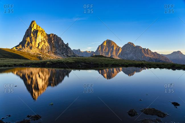Italy- Veneto- Dolomites- Giau Pass- Gusela and Tofana at sunrise