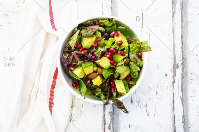Detox salad bowl with avocado- pomegranate seeds- roasted soybeans- sunflower seeds and nuts
