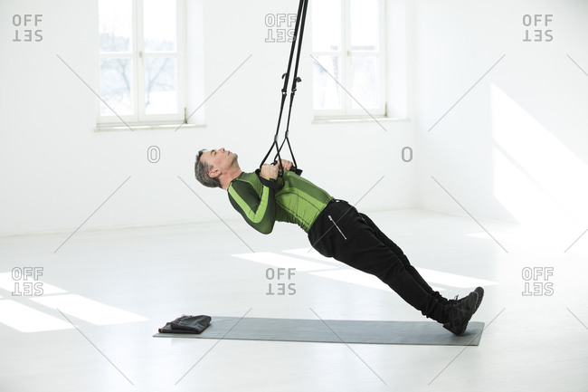 Man doing his fitness regime- doing suspension training