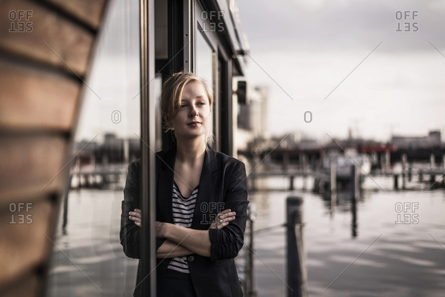 Woman leaning in window of a houseboat- taking a break