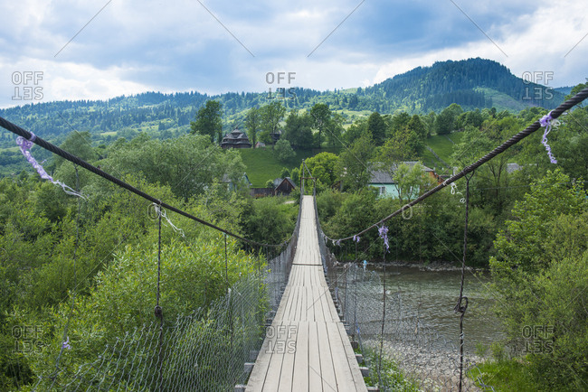 Ukraine- Carpathian mountains- Swinging bridge in Yasinia village