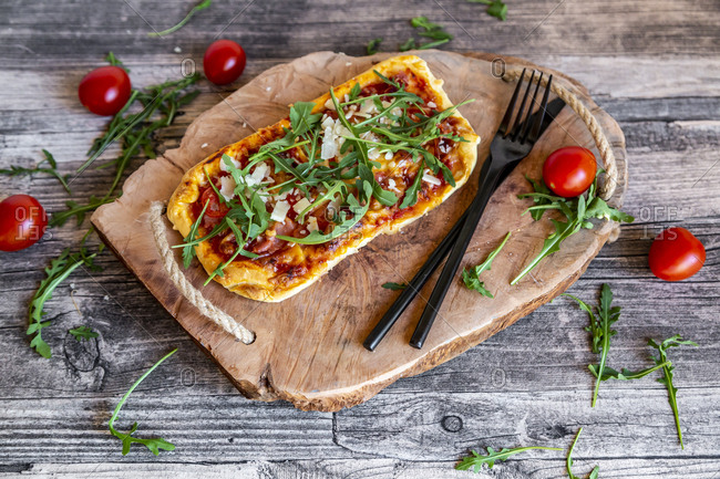Homemade pizza with rocket- parma ham- tomato and parmesan