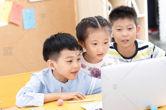 Elementary school students use computers in the classroom