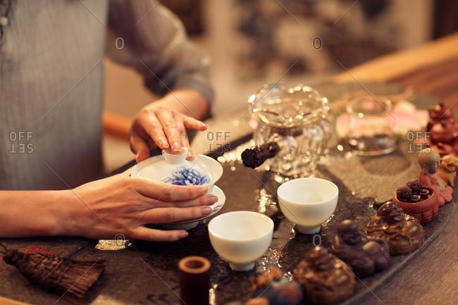 Young women make tea
