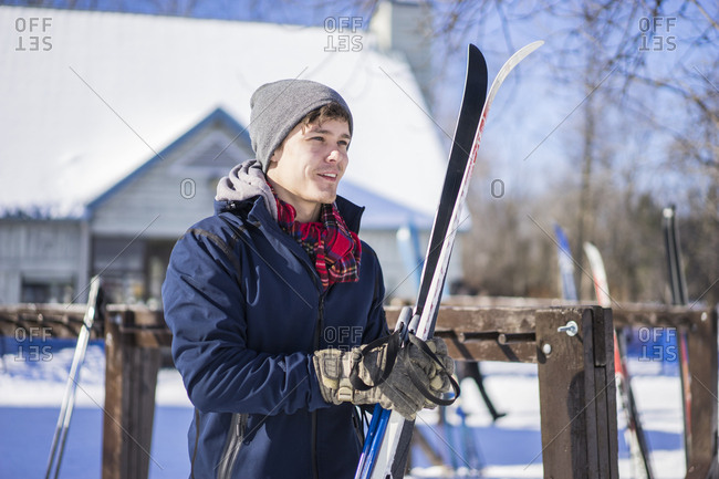 Millennial man about to cross country ski