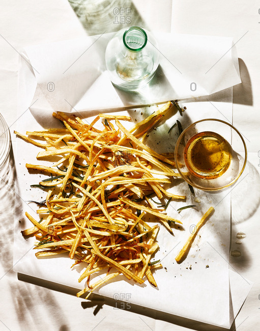 Overhead view of traditional French fries and beer