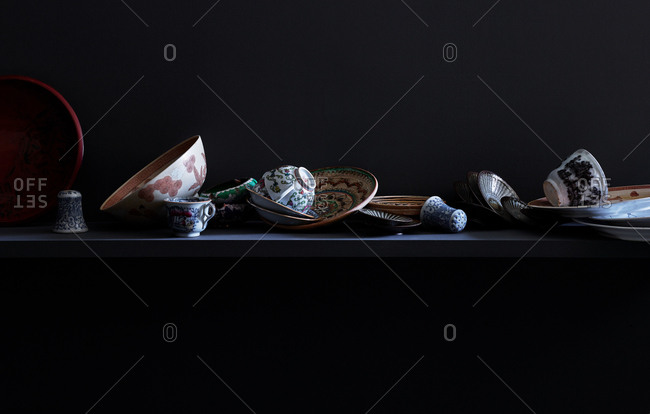 Variety of dishes strewn upon a shelf