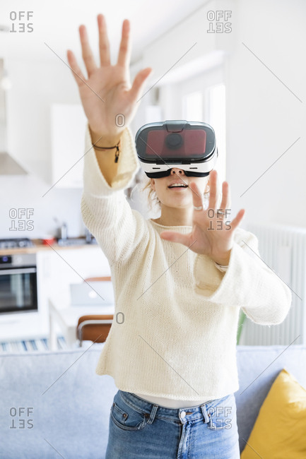 Young Woman Trying VR Glasses