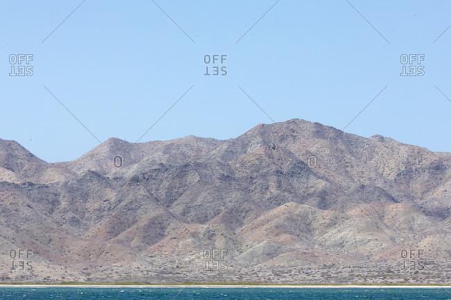 Mountains on blue coast in Baja California