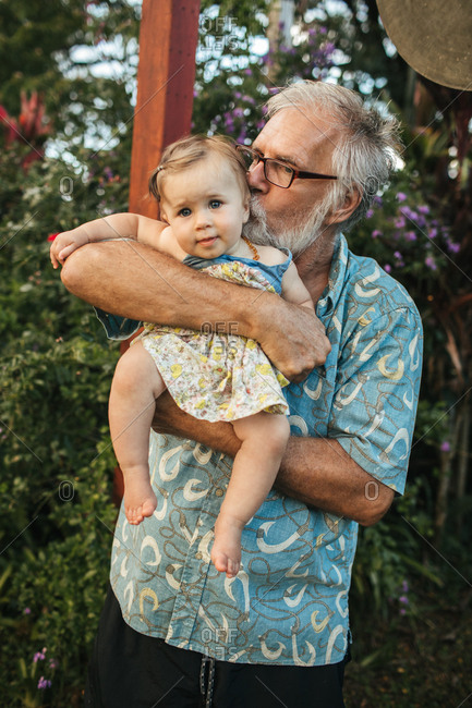 Grandpa holding his baby granddaughter