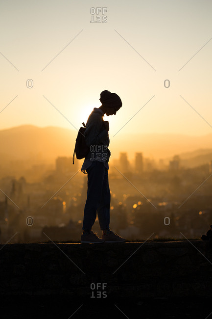 Woman stands on a ledge in Sarajevo, Bosnia