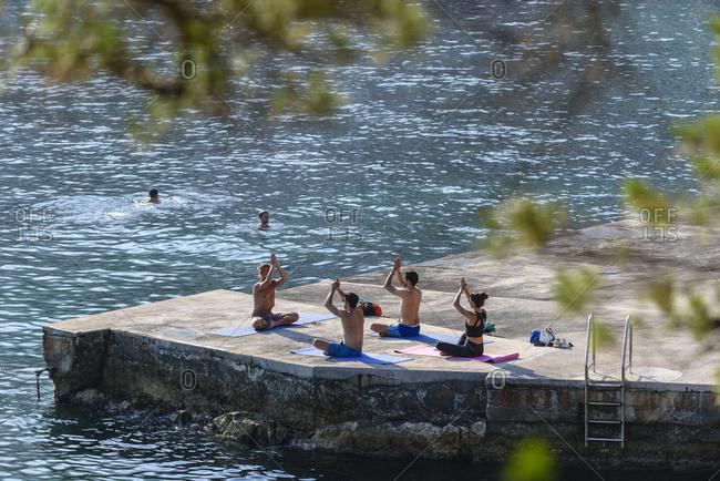 Monaco - June 30, 2018: Yoga course by the sea
