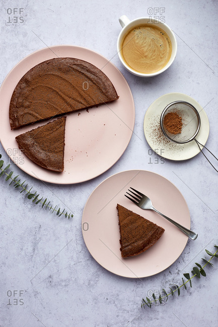 Slice of Kladdkaka Swedish Chocolate Cake with Coffee and Cocoa Dusting without Napkin