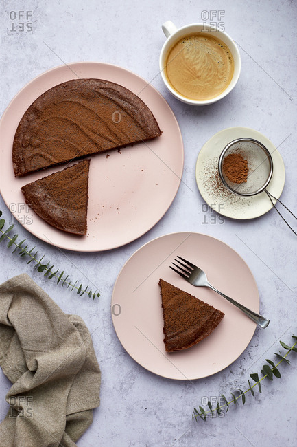 Slice of Kladdkaka Swedish Chocolate Cake with Coffee and Cocoa Dusting  with Napkin