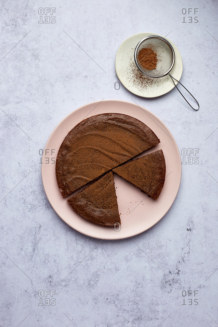 Sliced Kladdkaka Swedish Chocolate Cake with Cocoa Dusting