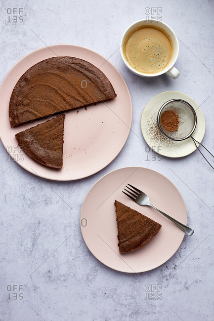 Simple Sliced Kladdkaka Swedish Chocolate Cake with Coffee and Cocoa Dusting, Fika