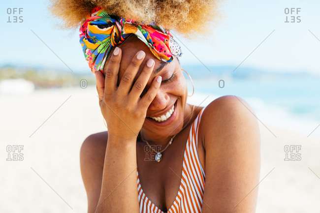 Closeup portrait of a smiling woman at beach in summer.