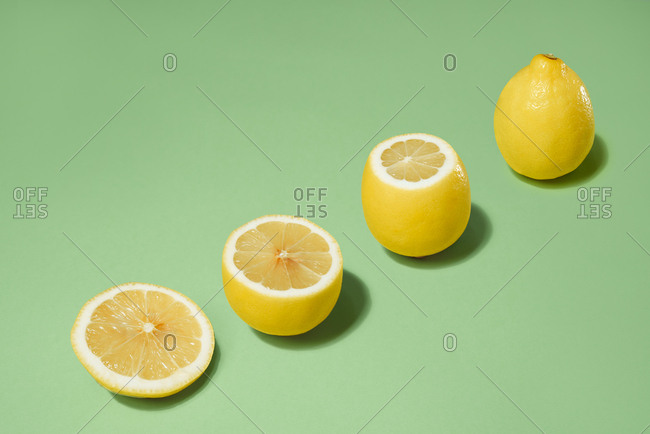 healthy food. sliced lemon isolated on green background. Development Concept.