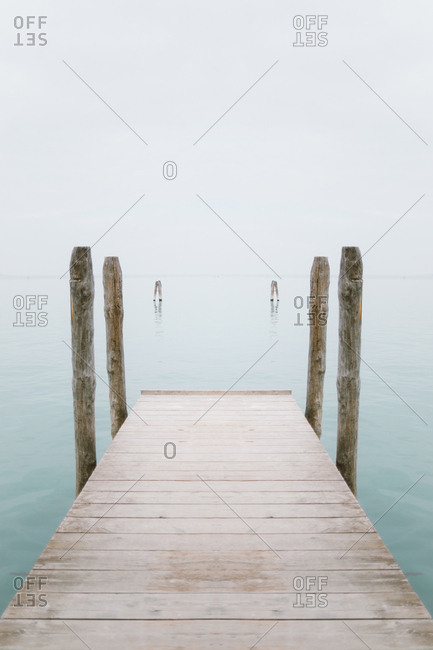 Fantasy wooden pier on a beautiful blue water