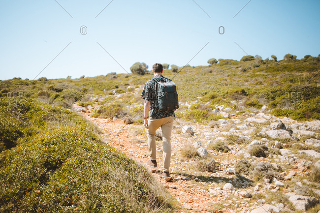 Man hiking a coast trail, Mediterranean