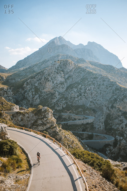 Amazing view of a mountain and a cyclist going downhill