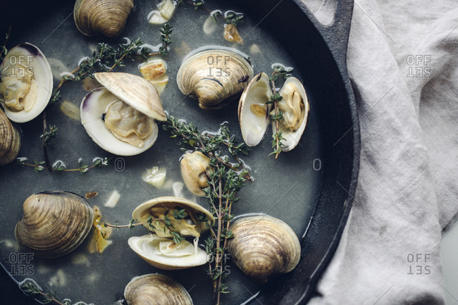 Overhead view of clams in a skillet