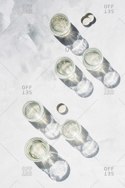 Overhead view of glass jars filled with sparkling beverages
