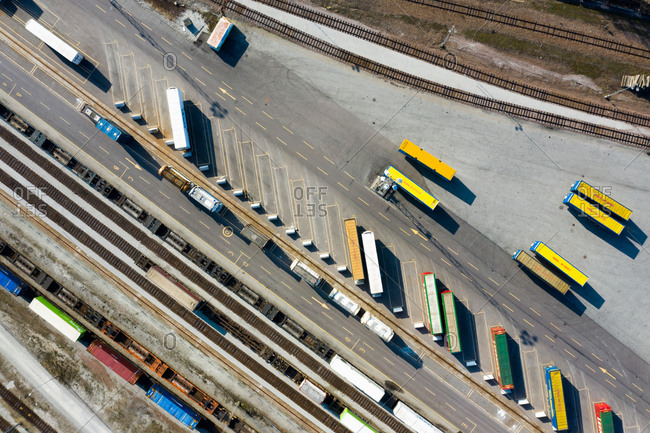Malmo, Sweden - March 29, 2019: Aerial view of trailers by train tracks