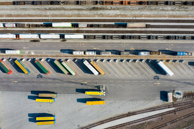 Malmo, Sweden - March 29, 2019: Overhead view of trailers by train tracks