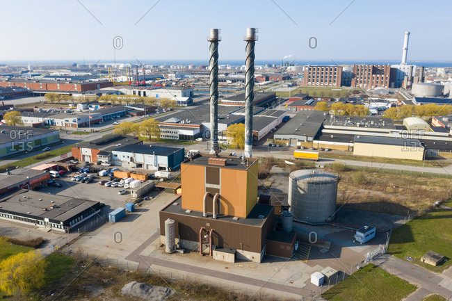 Malmo, Sweden - March 29, 2019: Elevated view over urban buildings and factory