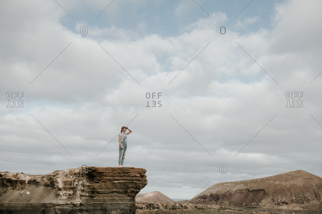 Anonymous female standing of stony terrain