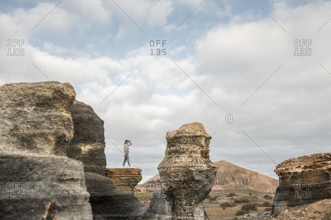 Anonymous female standing of stony terrain