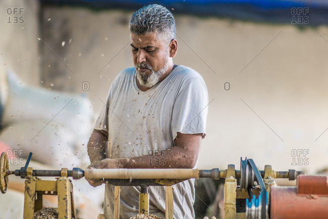 Man using woodworking machine at workplace