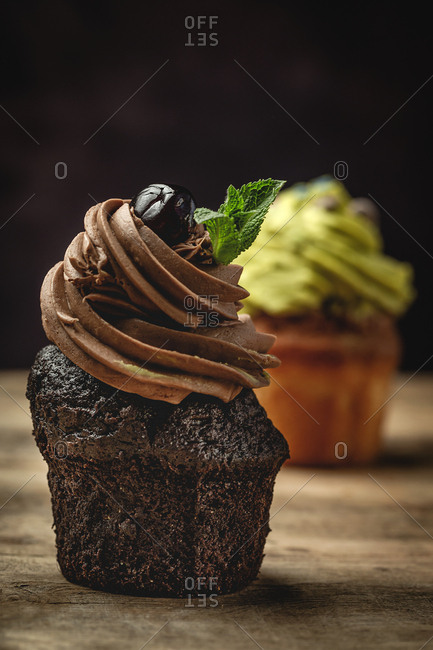 Delicious homemade cupcakes on rustic background